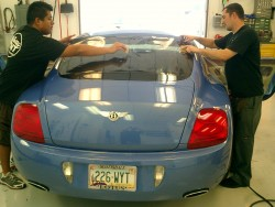 A Better Tint technicians installing ppf clear bra and window tint on Bentley in Scottsdale
