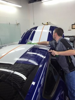 Auto tint Scottsdale specialist installing 3M window tint film on Ford Mustang